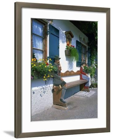 Figures Carved on a Bench on a Decorative House Front at Garmisch Partenkirchen in Bavaria, Germany-Gavin Hellier-Framed Photographic Print