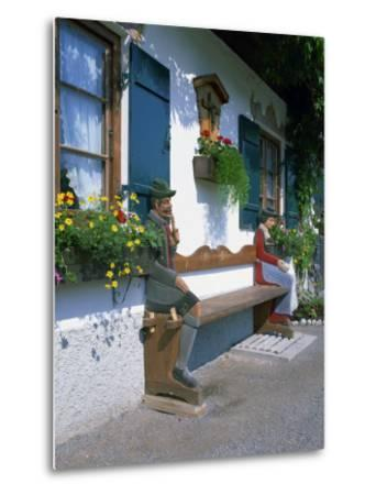 Figures Carved on a Bench on a Decorative House Front at Garmisch Partenkirchen in Bavaria, Germany-Gavin Hellier-Metal Print