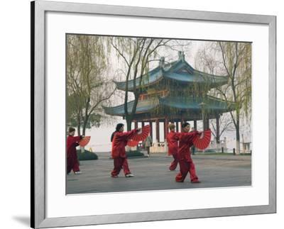 Women Practising Tai Chi in Front of a Pavilion on West Lake, Hangzhou, Zhejiang Province, China-Kober Christian-Framed Photographic Print