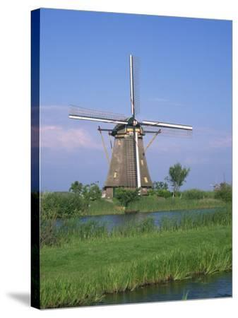 Thatched Windmills on the Canal at Kinderdijk, UNESCO World Heritage Site, Holland, Europe-Rainford Roy-Stretched Canvas Print