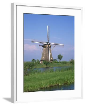 Thatched Windmills on the Canal at Kinderdijk, UNESCO World Heritage Site, Holland, Europe-Rainford Roy-Framed Photographic Print