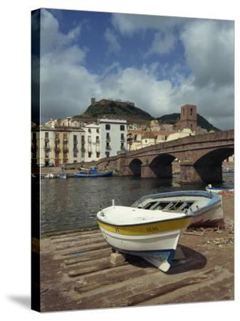 Boats Beside a Bridge over the Temo River at Bosa on the Island of Sardinia, Italy, Europe-Terry Sheila-Stretched Canvas Print