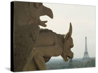 Gargoyles on Notre Dame Cathedral, and Beyond, the Eiffel Tower, Paris, France, Europe-Woolfitt Adam-Stretched Canvas Print