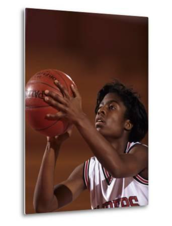 Female High Schooll Basketball Player in Action Shooting a Free Throw During a Game--Metal Print