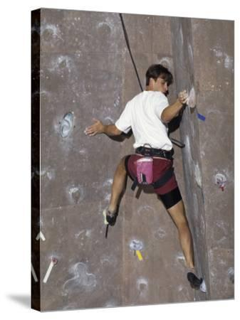 Man Wall Climbing Indoors with Equipment--Stretched Canvas Print