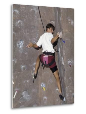 Man Wall Climbing Indoors with Equipment--Metal Print