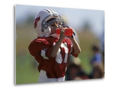 8 Year Old Boy Taking a Drink During a Football Game--Metal Print