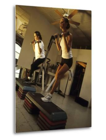 Women Performing Step Exercise with Handweights in Gym--Metal Print