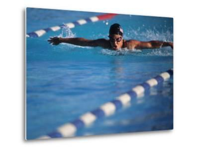 Female Swimmer Competing in a Butterfly Race--Metal Print