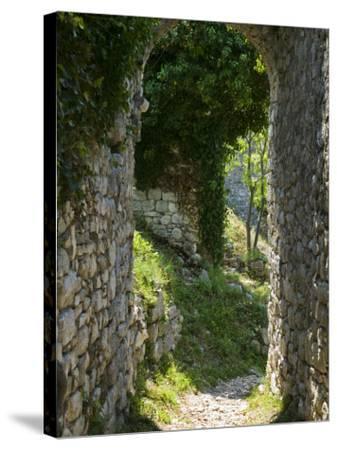Ancient Archway, Stari, Bar, Montenegro-Walter Bibikow-Stretched Canvas Print