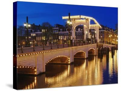 Dusk view of Magere Brug or Skinny Bridge and Amstel River, Netherlands, Holland-Adam Jones-Stretched Canvas Print