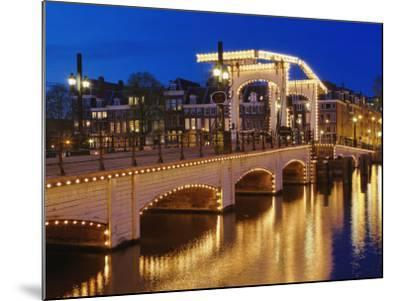 Dusk view of Magere Brug or Skinny Bridge and Amstel River, Netherlands, Holland-Adam Jones-Mounted Photographic Print