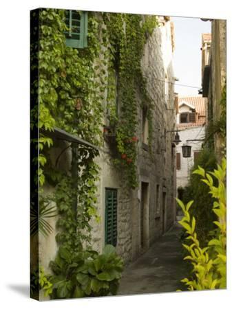 Narrow alley with historic stone buildings, Trogir, Dalamatia, Croatia-John & Lisa Merrill-Stretched Canvas Print