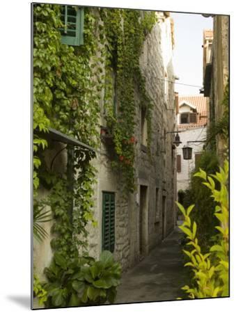 Narrow alley with historic stone buildings, Trogir, Dalamatia, Croatia-John & Lisa Merrill-Mounted Photographic Print