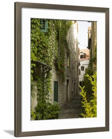 Narrow alley with historic stone buildings, Trogir, Dalamatia, Croatia-John & Lisa Merrill-Framed Photographic Print