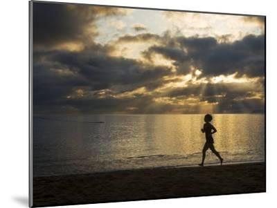 Silhouetted Woman Jogging on a Beach at Twilight-Mattias Klum-Mounted Photographic Print