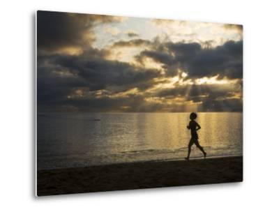 Silhouetted Woman Jogging on a Beach at Twilight-Mattias Klum-Metal Print