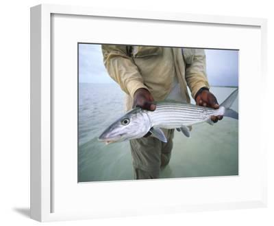 Fisherman Holds Out a Bonefish Off Great Exuma Island-Michael Melford-Framed Photographic Print