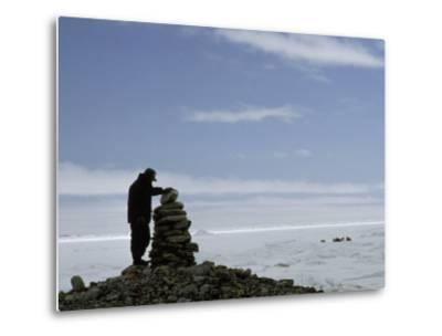 Inuit Hunter Surveys a Sacred Inuksuk Monument, Used as a Waypost-Gordon Wiltsie-Metal Print