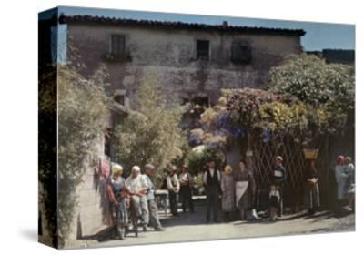 Locals Gather under Flowered Gateways Outside Rome-Hans Hildenbrand-Stretched Canvas Print