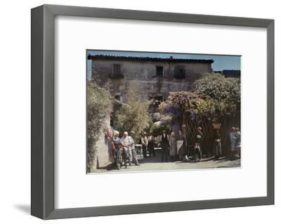 Locals Gather under Flowered Gateways Outside Rome-Hans Hildenbrand-Framed Photographic Print