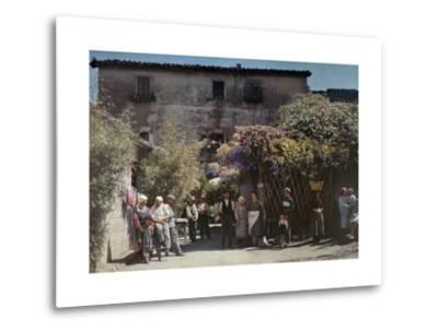 Locals Gather under Flowered Gateways Outside Rome-Hans Hildenbrand-Metal Print