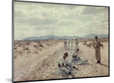 French Foreign Legion Works to Build Roads in the Algerian Desert-Gervais Courtellemont-Mounted Photographic Print