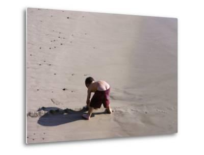 Boy's Bottom Peeks Out from His Bathing Suit as He Plays in Sand-White & Petteway-Metal Print