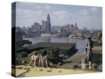 Women Look at Baltimore's Downtown from across the Patapsco River-W^ Robert Moore-Stretched Canvas Print