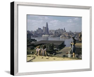 Women Look at Baltimore's Downtown from across the Patapsco River-W^ Robert Moore-Framed Photographic Print
