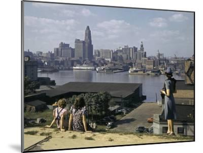 Women Look at Baltimore's Downtown from across the Patapsco River-W^ Robert Moore-Mounted Photographic Print