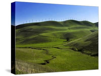 Wind Turbines Line a Mountain Ridge Above a Fertile Farming Valley-White & Petteway-Stretched Canvas Print