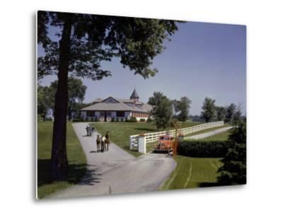 View of the Grounds at Calumet Farm, Where Race Horses are Held-B^ Anthony Stewart-Metal Print