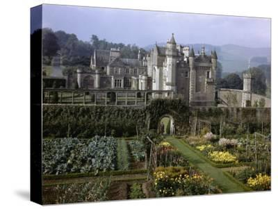 Tourists Walk in Gardens of Abbotsford House-B^ Anthony Stewart-Stretched Canvas Print