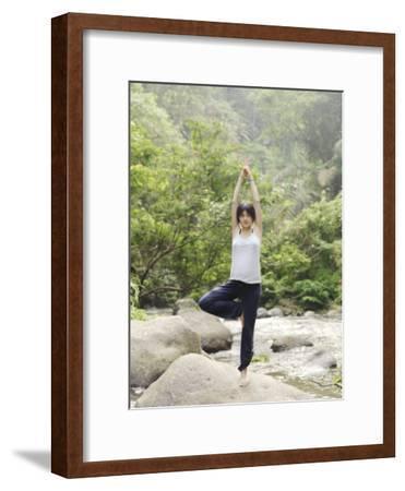Pregant Woman Pratices Yoga on the Rocks Near a River in Bali-xPacifica-Framed Photographic Print