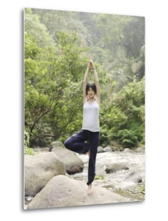 Pregant Woman Pratices Yoga on the Rocks Near a River in Bali-xPacifica-Metal Print