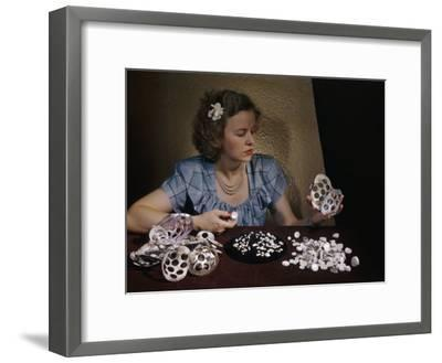 Woman Holds Mussel Shells and Pearl Buttons Made from Those Shells-Willard Culver-Framed Photographic Print