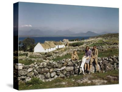 Teenagers Relax on a Stonewall Near their Home in Connemara-Howell Walker-Stretched Canvas Print