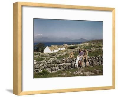 Teenagers Relax on a Stonewall Near their Home in Connemara-Howell Walker-Framed Photographic Print