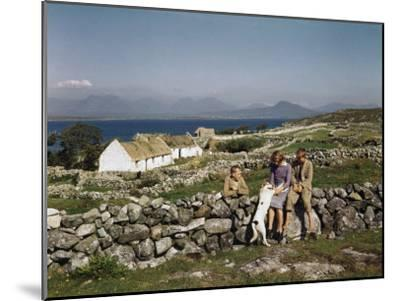 Teenagers Relax on a Stonewall Near their Home in Connemara-Howell Walker-Mounted Photographic Print