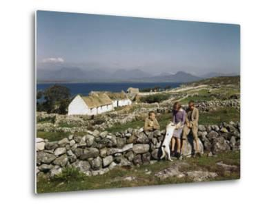 Teenagers Relax on a Stonewall Near their Home in Connemara-Howell Walker-Metal Print