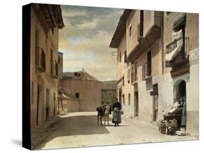 Woman and Donkey Stand in an Empty Street in Segovia-Gervais Courtellemont-Stretched Canvas Print
