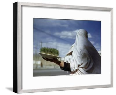 Woman Holds Plate Containing New Grain Sprouts to Celebrate New Year-Maynard Owen Williams-Framed Photographic Print