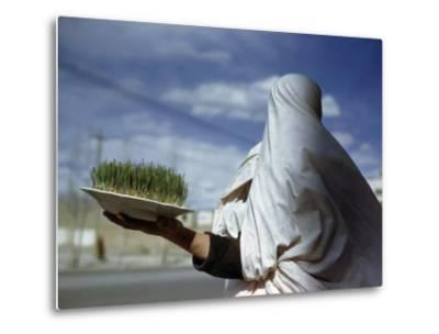Woman Holds Plate Containing New Grain Sprouts to Celebrate New Year-Maynard Owen Williams-Metal Print