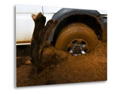 Tire Spinning in Deep Clay Mud-Mattias Klum-Metal Print