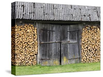 Barn Door Surrounded by Firewood Stacks-Keenpress-Stretched Canvas Print