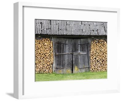 Barn Door Surrounded by Firewood Stacks-Keenpress-Framed Photographic Print