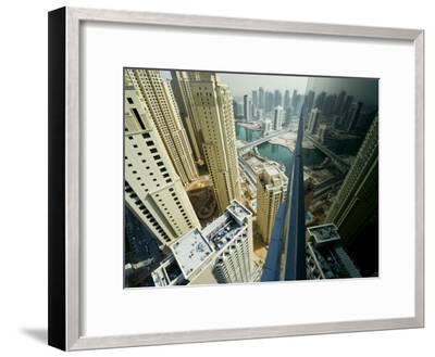 Cityscape of High Rises and Waterways in Downtown Dubai-Mattias Klum-Framed Photographic Print