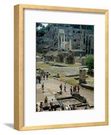 Tourists Walk Through Rome's Ancient Forum with Palatine Hill Behind-O^ Louis Mazzatenta-Framed Photographic Print