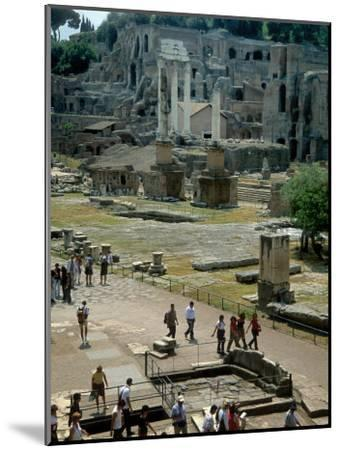 Tourists Walk Through Rome's Ancient Forum with Palatine Hill Behind-O^ Louis Mazzatenta-Mounted Photographic Print